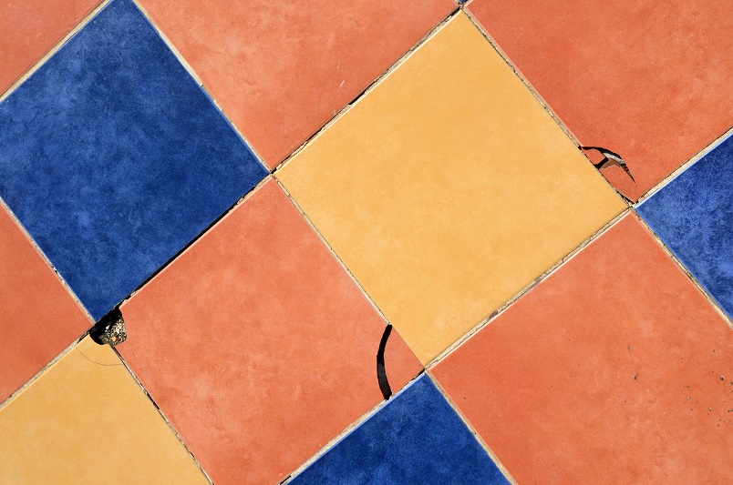 cracked floor tiles crumbling grout